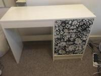 White desk with patterned drawers