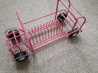 Cd holder rack in pink bus shape