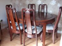 Rosewood Dining Table and 6 Chairs.
