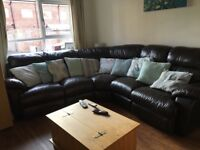 Large leather corner sofa, 7 seats. End seats with electric recliners