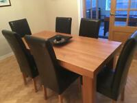 Solid oak dining table and 6 leather chairs £450 cost £2700 new!