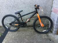 BRAND NEW jump bike orange and black X-RATED + BRAND NEW blue and black helmet