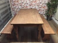 Rustic solid pine dining table with 2 pine benches.