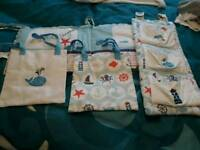 Cot bumper and storage bags