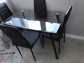 Glass dining table 4 black chairs