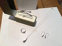Brand new Silver bracelet, earrings, ring, pendant and chain