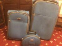 Light blue suitcase set