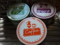 M & S colourful storage tins