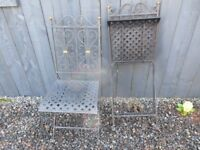 Pair of black metal foldable garden chairs