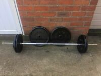 SOLID BARBELL PLUS 90KG OF CAST IRON WEIGHT PLATES