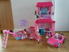 Barbie house with car and pool plus accessories and 4 barbie dolls