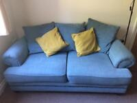 Blue fabric two seater sofa and chair