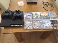 ps3 with 2 controllers and games