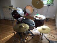 drum kit , 8 piece dragon drum kit, brand new symbols , drum stool , 2 books and music stand .