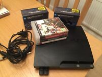 PS3 Black Console + 2 Controllers + 4 Games