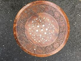 Small solid round plant display table