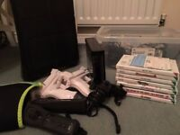 Nintendo Wii Games Console incl. 2 controllers, 7 games, 2 nunchucks, 2 guns, wii fit board