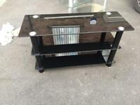 Two black glass tv stands