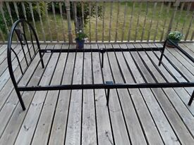 Black single bed with mattress