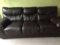Large 3 seater leather sofa bed and reclining chair. Dark Brown. Really good condition.