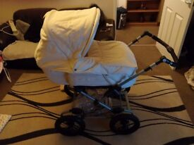 Silver Cross pram/stroller with baby bag and rain cover. Cream
