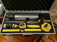 Laser level in case with tripod