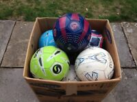 BOX OF USED FOOTBALLS SIZE 4 AND 5