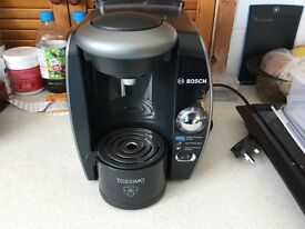 Tassimo coffee machine with water filter option includes some pods.