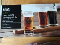 Beer tasting glasses with serving paddle