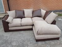 Beautiful corner sofa.Brown leather base and beige fabric cushions.BRAND NEW. can deliver