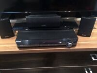 Sony DVD player with surround speakers