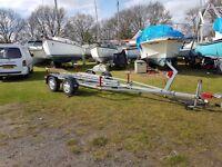 Twin axle break back boat trailer