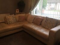 Cream leather l shaped sofa with stool