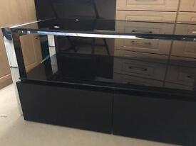 Black glass/chrome tv bench and storage.