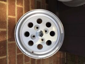 4 X RARE WOLFRACE PEPPERPOT WHEELS, FORD FITTING. ALLOYS WITH WHITE CENTRE. NEVER HAD TYRES FITTED.