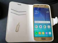 Samsung Galaxy s6. Unlocked with case. Gold.