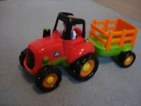 ELC tractor with farmer and trailer