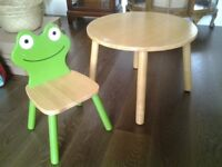 Round wooden children's tabke and frog chair.