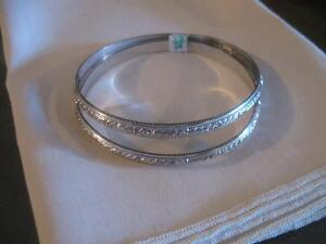 PAIR of BRILLIANT SILVERTONE BANGLE BRACELETS...From the 60s