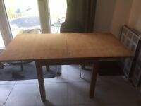 Wood dining table, 4 seater but can be extended into a 6-8 seater.