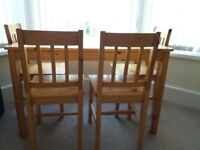 1 Solid Pine dining table & 4 chairs.