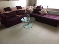 Raspberry Corner sofa complete with foot stool
