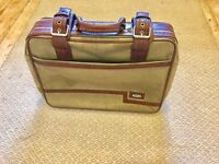 Small Old fashioned in-between hand luggage fabric suitcase