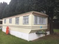 SITED STATIC CARAVAN NEAR BEWDLEY WITH SWIMMING POOLS AND CLUBHOUSE