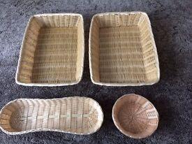 Set of four plastic wicker baskets