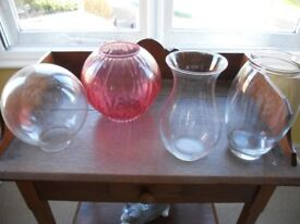 Two very attractive clear glass vases and two glass globes