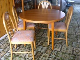 Wooden Round (but extendable) Dining table and 4 chairs