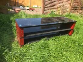 Glass and red metal Tv stand