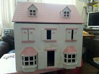 Wooden dolls house in need of repair