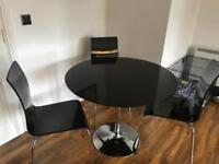 Black dinning table and four chairs